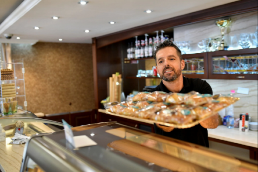 """An employee of Karl Confectionery puts """"A bite of Heaven"""", deserts created by a Hungarian confectioner Zsolt Karl on the counter in Dunaharaszti, Hungary, September 7, 2021. REUTERS/Marton Monus"""
