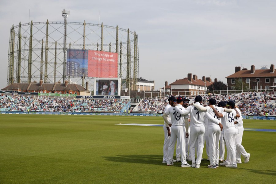 India's Virat Kohli and teammates in a huddle before play — Action Images via Reuters