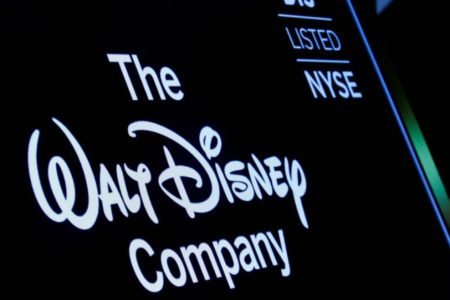 A screen shows the logo and a ticker symbol for the Walt Disney Company on the floor of the New York Stock Exchange (NYSE) in New York, U.S., December 14, 2017. REUTERS/Brendan McDermid