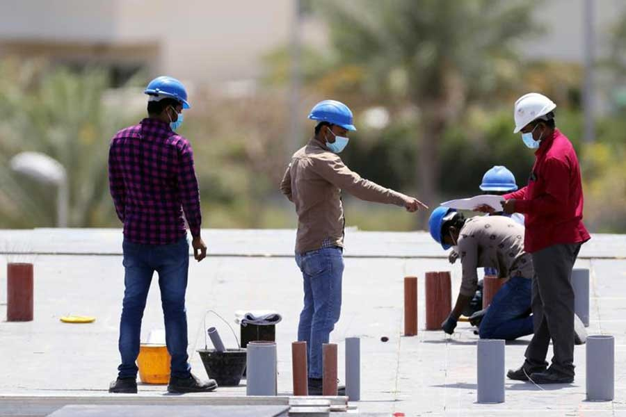 Workers wearing protective face masks work on a residential construction site, following the outbreak of coronavirus disease (COVID-19), in Dubai of United Arab Emirates on April 14 last year –Reuters file photo