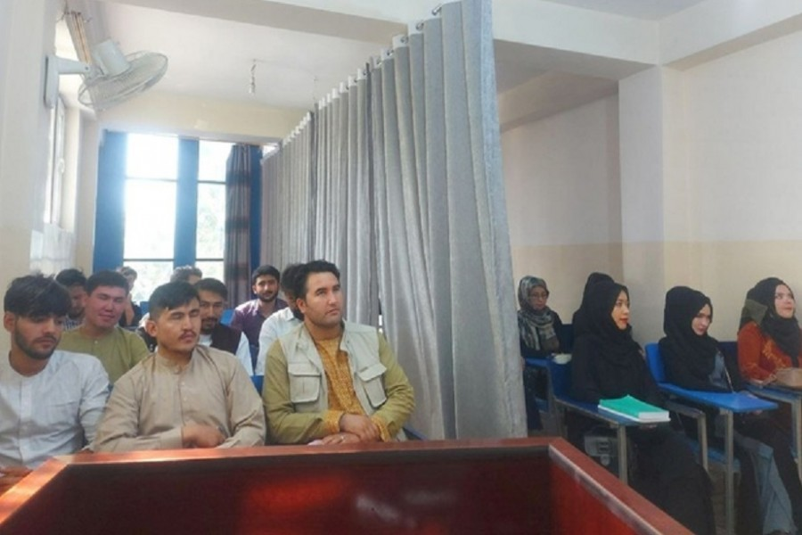 Students attend class under new classroom conditions at Avicenna University in Kabul, Afghanistan September 6, 2021, in this picture obtained by REUTERS from social media. Social media handout/via REUTERS