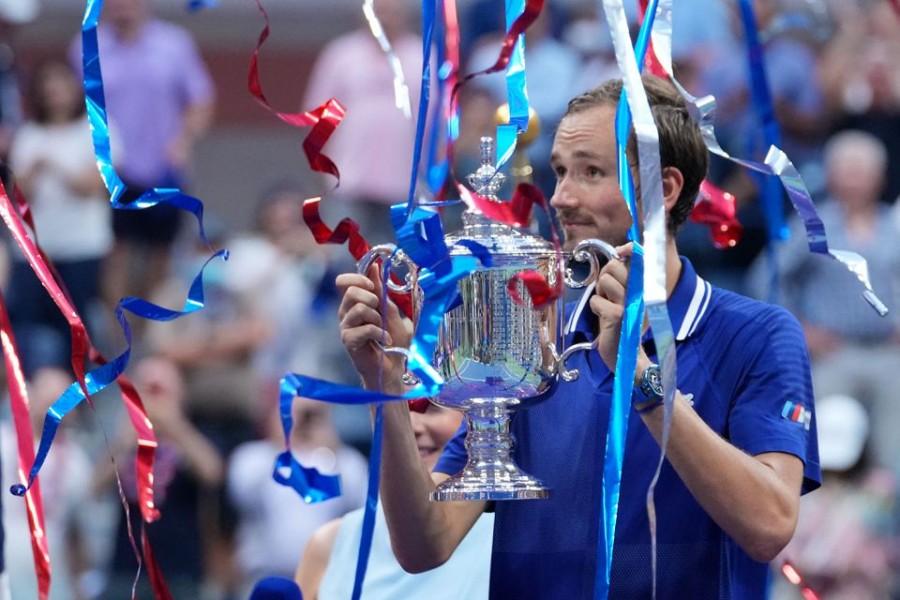 Daniil Medvedev of Russia celebrates with the championship trophy after his match against Novak Djokovic of Serbia (not pictured) in the men's singles final on day fourteen of the 2021 US Open tennis tournament at USTA Billie Jean King National Tennis Center — USA TODAY Sports via Reuters