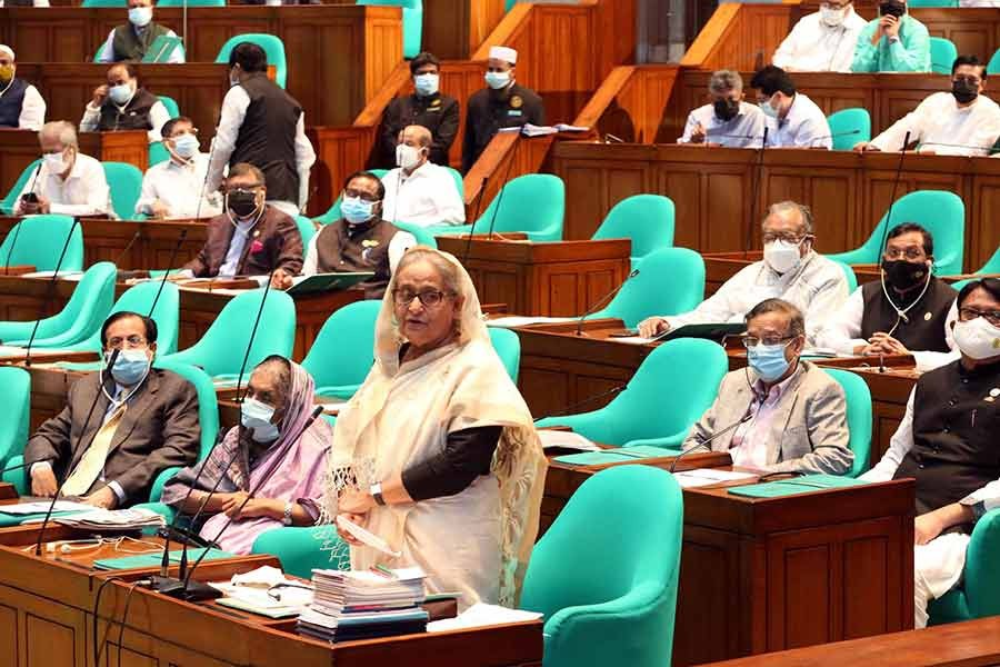 Prime Minister Sheikh Hasina taking part in a discussion on a condolence motion for a lawmaker in the parliament on Tuesday –PID Photo
