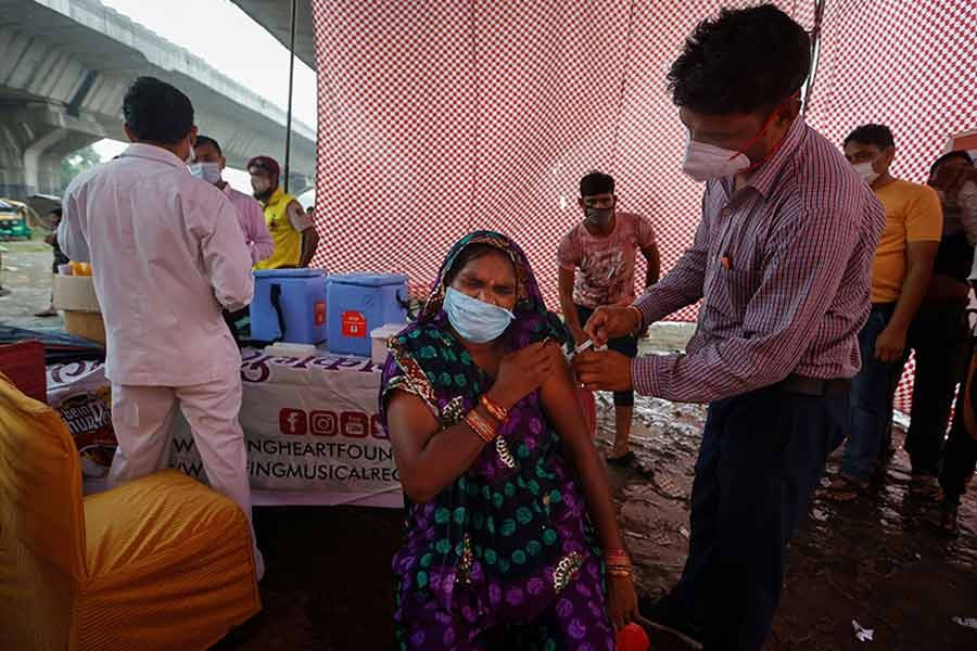 A woman receiving a dose of COVAXIN coronavirus disease (COVID-19) vaccine at an under-construction flyover in New Delhi of India on August 31 this year –Reuters file photo