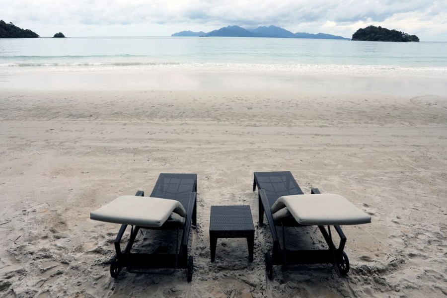 Empty chairs are seen at The Datai Langkawi resort beach, as Langkawi gets ready to open to domestic tourists from September 16, amid the coronavirus disease (COVID-19) outbreak, Malaysia September 14, 2021. REUTERS/Lim Huey Teng