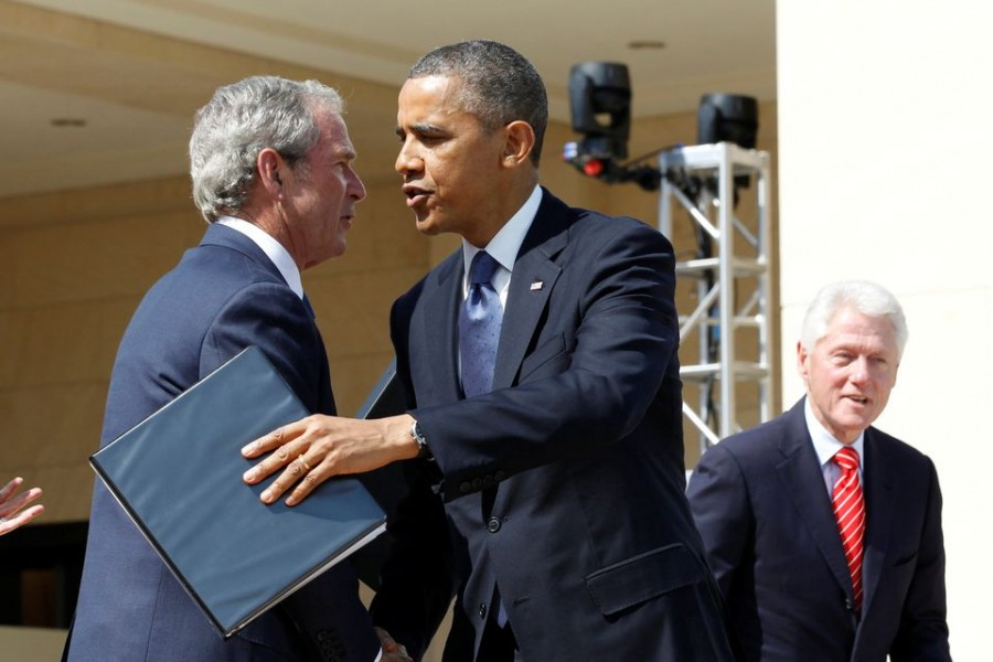US President Barack Obama embraces former President George W Bush following remarks at the dedication ceremony of the George W Bush Presidential Centre in Dallas, April 25, 2013. Former president Bill Clinton is pictured at right — Reuters/Files