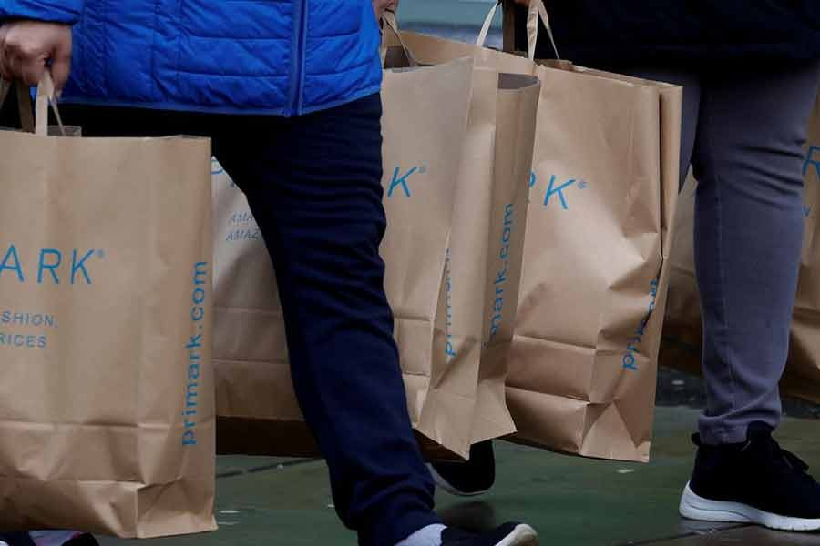 Shoppers carrying bags from Primark at the start of the Boxing Day sales amid the outbreak of the coronavirus disease (COVID-19) in Manchester of Britain on December 26 last year –Reuters file photo
