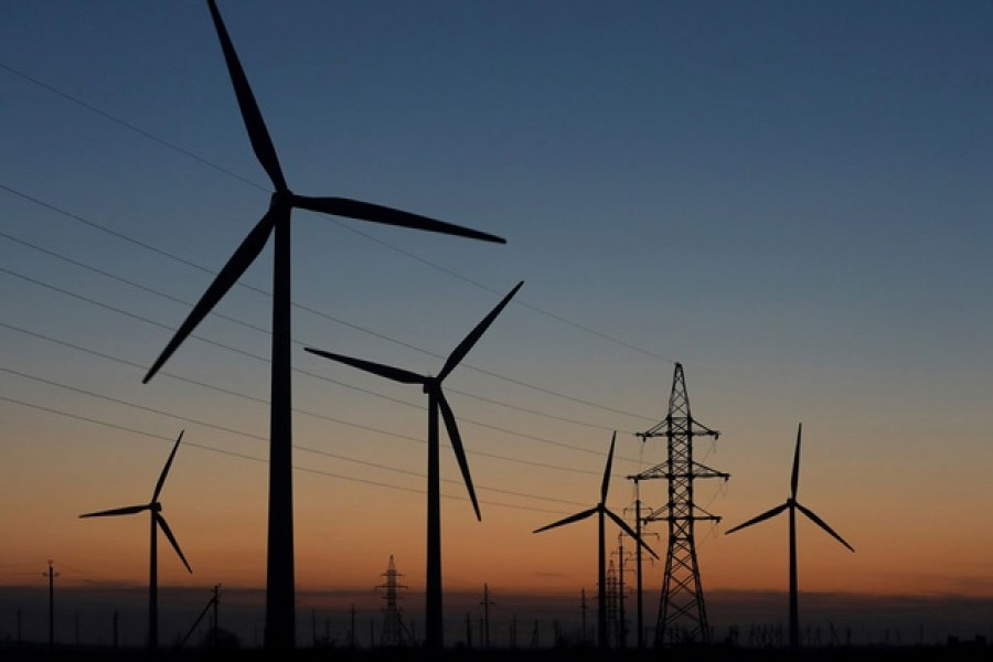Wind turbines are pictured during sunset in Almaty Region, Kazakhstan Nov 7, 2020. REUTERS/Pavel Mikheyev
