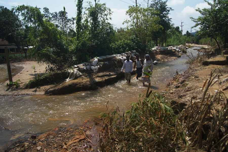 Water passing through ditches developed on Tahirpur-Tekerghat road in Sunamganj by rolling waters from Meghalaya hills —FE file photo