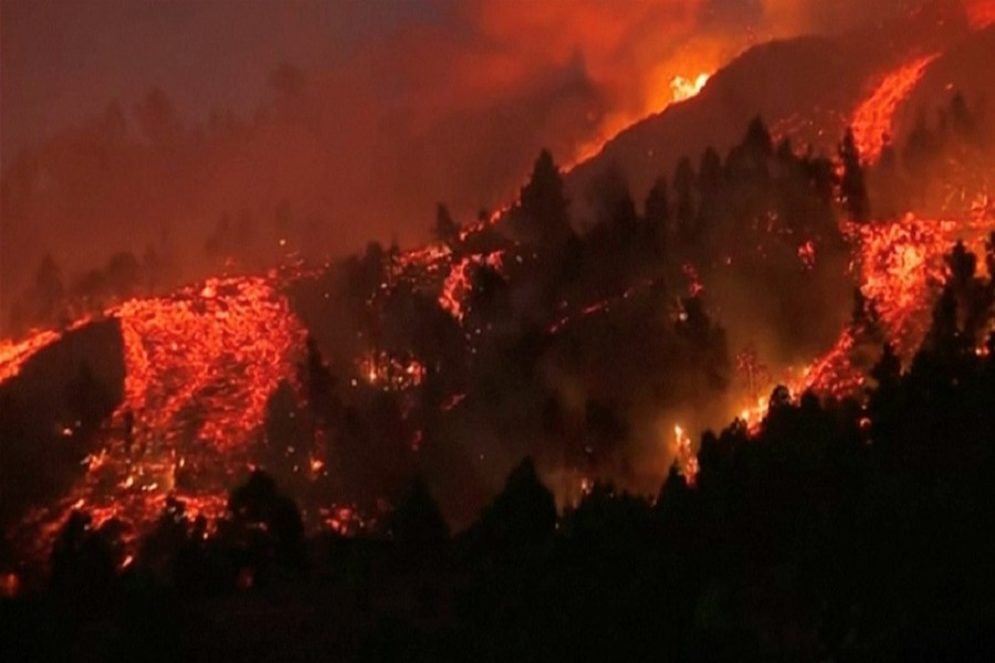 Red-hot lava spews from volcano in Spain's Canary Islands