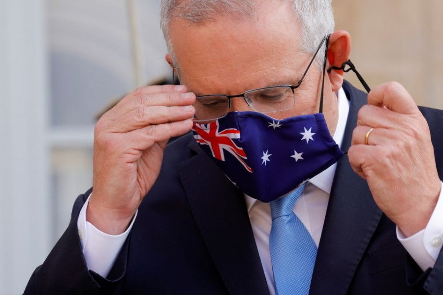 Australian Prime Minister Scott Morrison adjusts his mask during a news conference he holds with French President Emmanuel Macron in front of the Elysee Palace in Paris, France, June 15, 2021 — Reuters /Pascal Rossignol