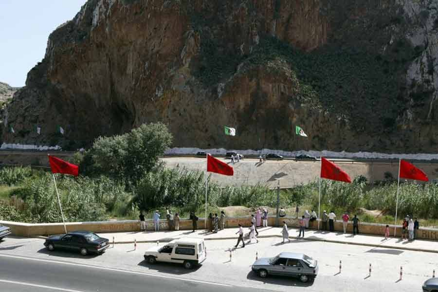 People standing near a border post on the Algerian side of the Morocco-Algeria border in the north east of Morocco –Reuters file photo