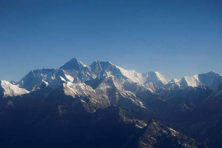 Mount Everest, the world highest peak, and other peaks of the Himalayan range are seen through an aircraft window during a mountain flight from Kathmandu of Nepal on January 15 last year –Reuters file photo
