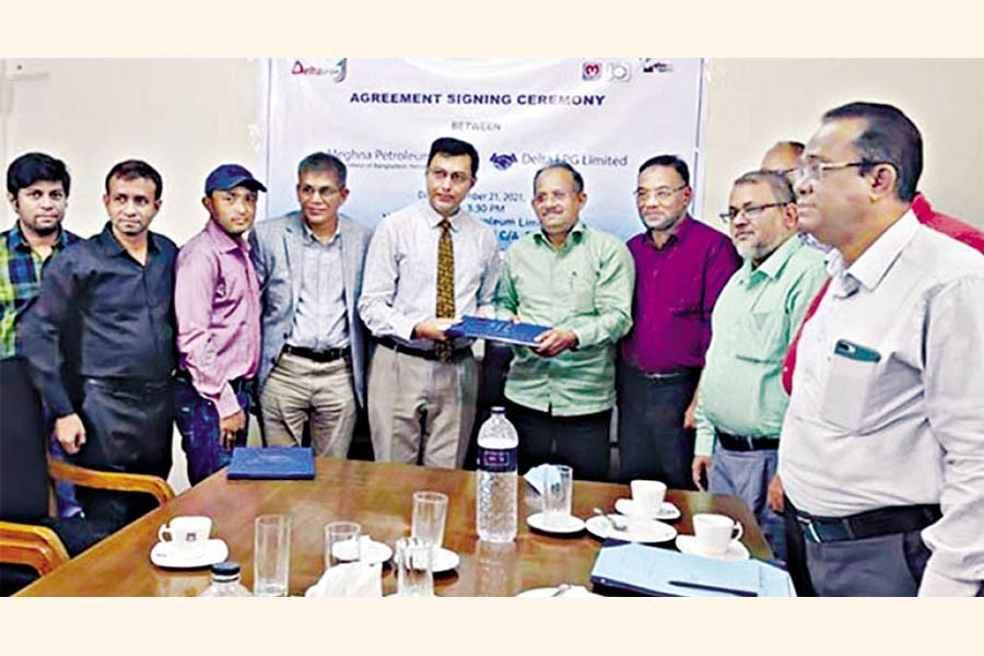 Managing Director of Meghna Petroleum Ltd Saifullah Al Khaled and Executive Director of Delta LPG Ltd Sabbir Ahmed exchanging documents after signing the agreement on behalf of their respective organisations at Meghna Petroleum's head office at Agrabad in the port city on Thursday
