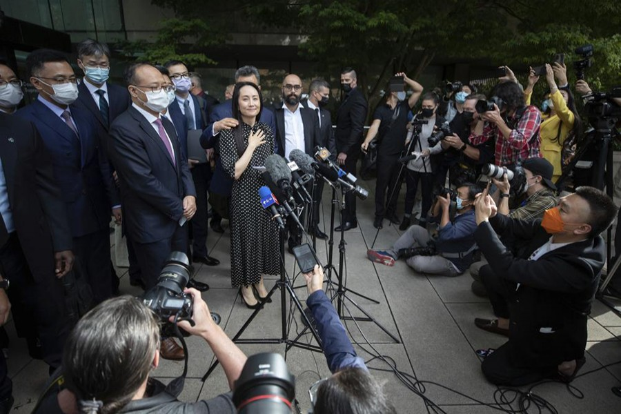Meng Wanzhou, chief financial officer of Huawei, prepares to read a statement outside BC Supreme Court in Vancouver, British Columbia, Friday, Sept 24, 2021 — Darryl Dyck/The Canadian Press via AP