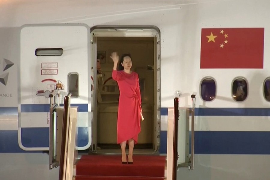 Huawei Technologies Chief Financial Officer Meng Wanzhou waves upon arriving from Canada at Shenzhen Baoan International Airport, in Shenzhen, Guangdong province, China September 25, 2021 — CCTV via Reuters