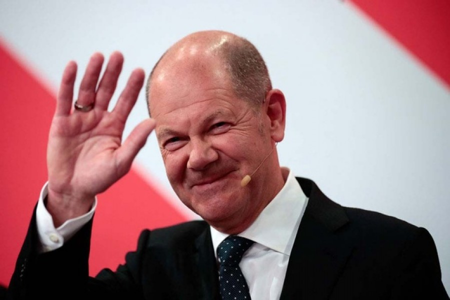 Social Democratic Party (SPD) leader and top candidate for chancellor Olaf Scholz reacts after first exit polls for the general elections in Berlin, Germany, September 26, 2021 -- Reuters