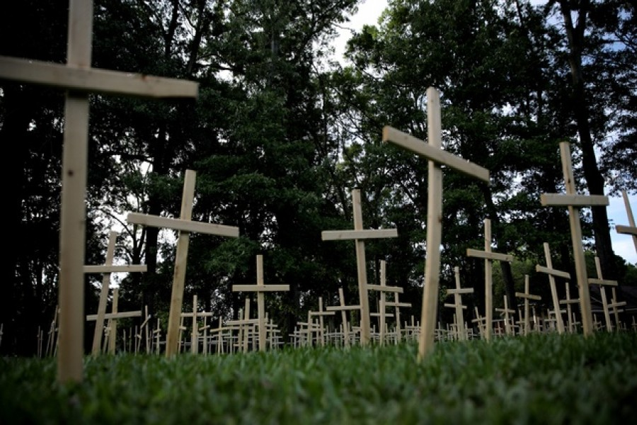 Crosses are seen outside of a church, as each cross represents one life lost to coronavirus disease (COVID-19) in the state of Louisiana, in Baton Rouge, Louisiana US, April 10, 2020. REUTERS