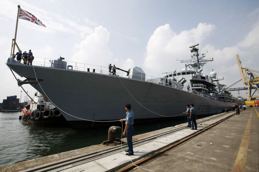 Officers of the Indonesian Navy greet the crew of the visiting British Royal Navy ship HMS Richmond docked at Tanjung Priok harbour in Jakarta May 22, 2011. REUTERS/Supri/Files