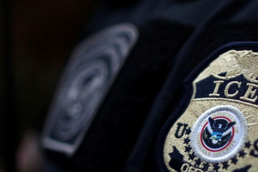 The badge of ICE Field Office Director, Enforcement and Removal Operations, David Marin and US Immigration and Customs Enforcement's (ICE) Fugitive Operations team search for a Mexican national at a home in Hawthorne, California, US on March 1, 2020 — Reuters/Files