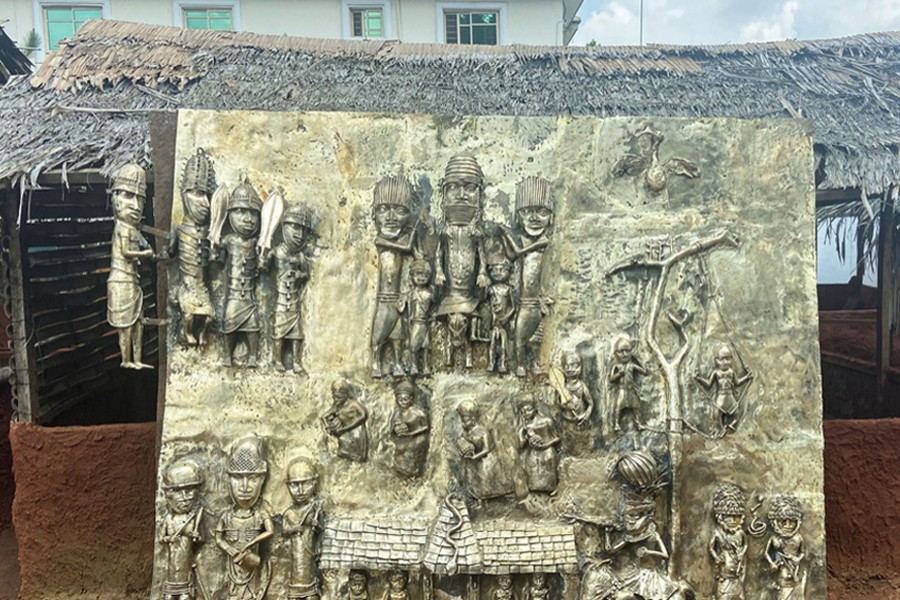 A newly made bronze plaque depicting historical events in West Africa's once mighty Kingdom of Benin, which is being offered as a gift to the British Museum, is seen on display in Benin City, Nigeria on July 31, 2021 — Reuters/Files