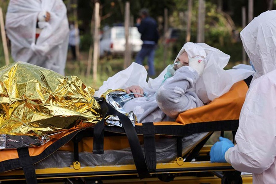 A COVID-19 patient, wounded in a fire that broke out at the intensive care unit of a COVID-19 hospital, is transported by medical professionals on a stretcher, in Constanta, Romania, Oct 1, 2021. Costin Dinca/ REUTERS