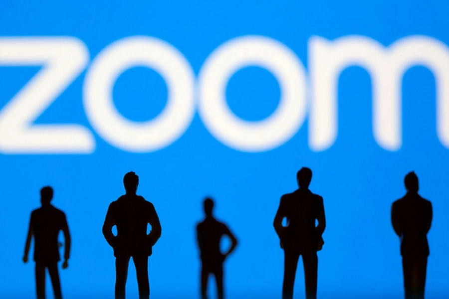 Small toy figures are seen in front of the Zoom logo in this illustration picture taken on March 15, 2021 — Reuters/Files