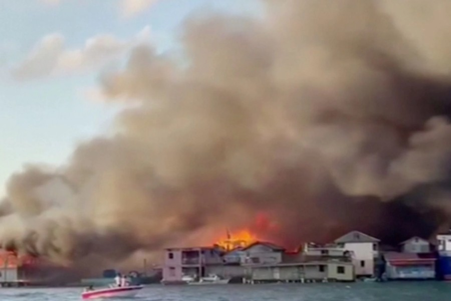 Smoke billows from a fire at a residential area on the island of Guanaja, Honduras in this screen grab taken from a video taken October 2, 2021. COPECO/Reuters TV via REUTERS