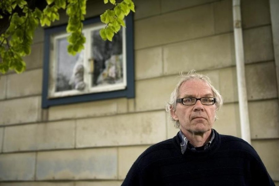 Swedish artist Lars Vilks poses beside his damaged kitchen window at his home outside Hoganas, Sweden on May 16, 2010 — Reuters/Files