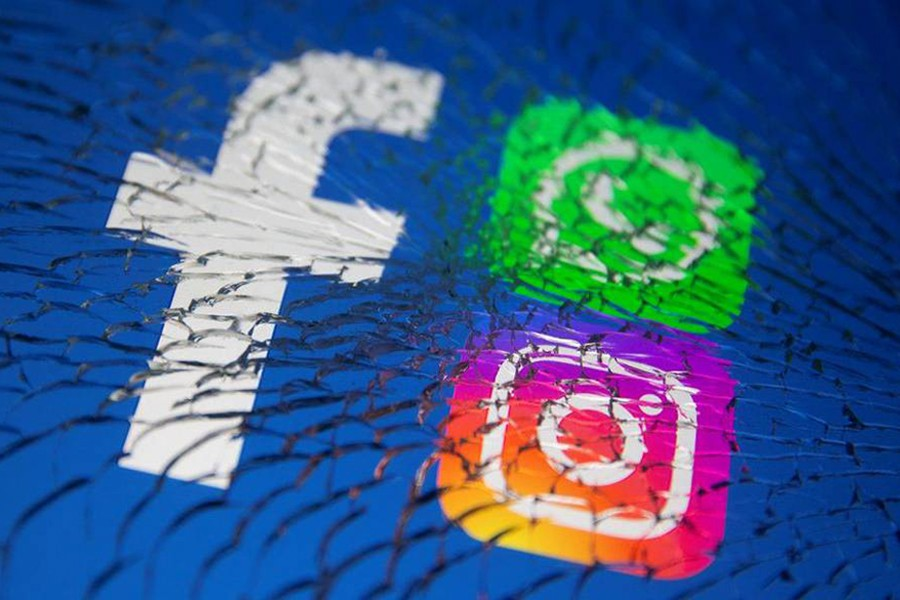 Facebook, Whatsapp and Instagram logos are displayed through broken glass in this illustration taken on October 4, 2021 — Reuters/Files
