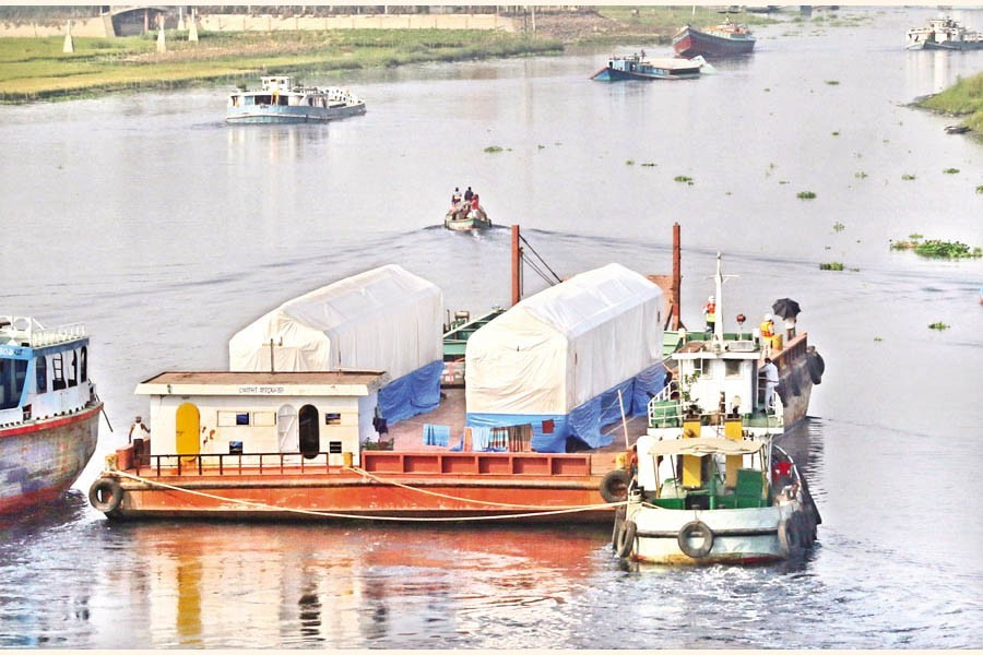 A barge sailing down the Turag river after crossing Birulia area on the outskirts of Dhaka few months ago —FE file photo