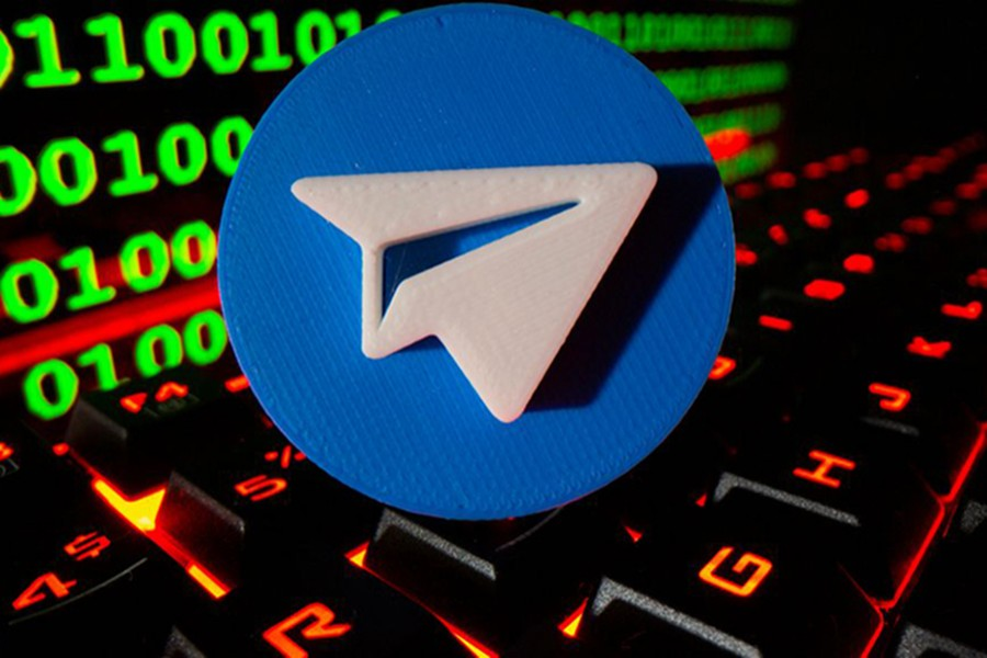 A 3D printed Telegram logo is pictured on a keyboard in front of binary code in this illustration taken on September 24, 2021 — Reuters/Files