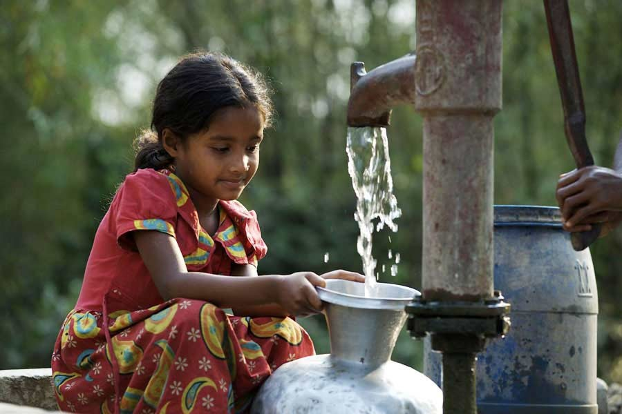 A girl collecting drinking water from a tube well at a village in Bangladesh.          —UNICEF Photo