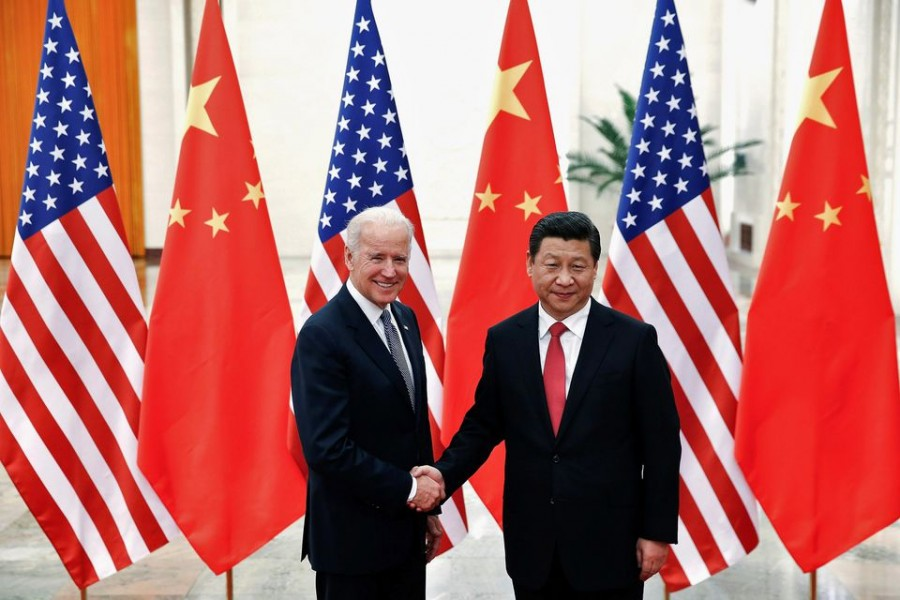 Chinese President Xi Jinping shakes hands with US Vice President Joe Biden (L) inside the Great Hall of the People in Beijing December 4, 2013. REUTERS/Lintao Zhang/Pool//File Photo