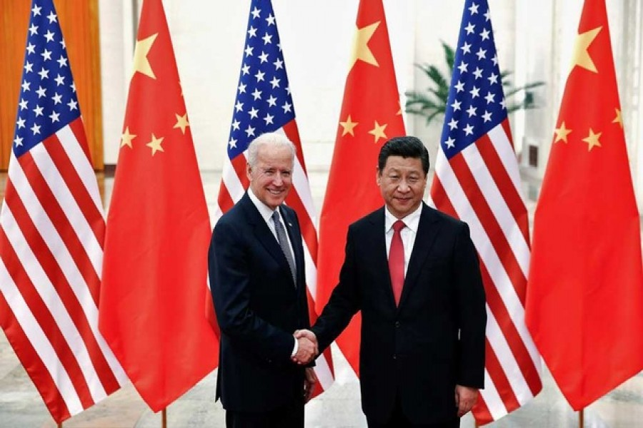Chinese President Xi Jinping shakes hands with US Vice President Joe Biden (L) inside the Great Hall of the People in Beijing, December 4, 2013 -- Reuters/Lintao Zhang/Pool//File Photo