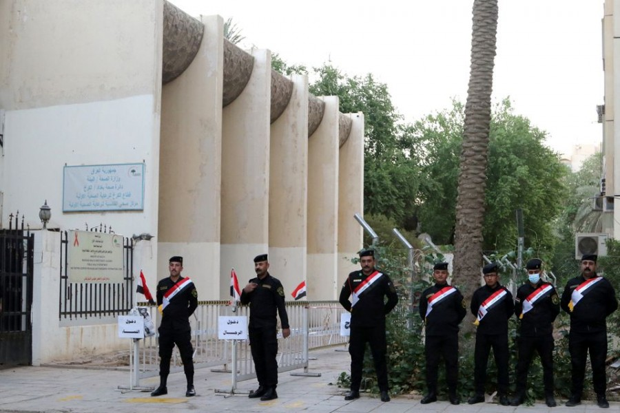 Iraqi security forces stand guard outside a polling station at the Green Zone in Baghdad, as Iraqis go to the poll to vote in the parliamentary election, in Iraq on October 10, 2021 — Reuters photo