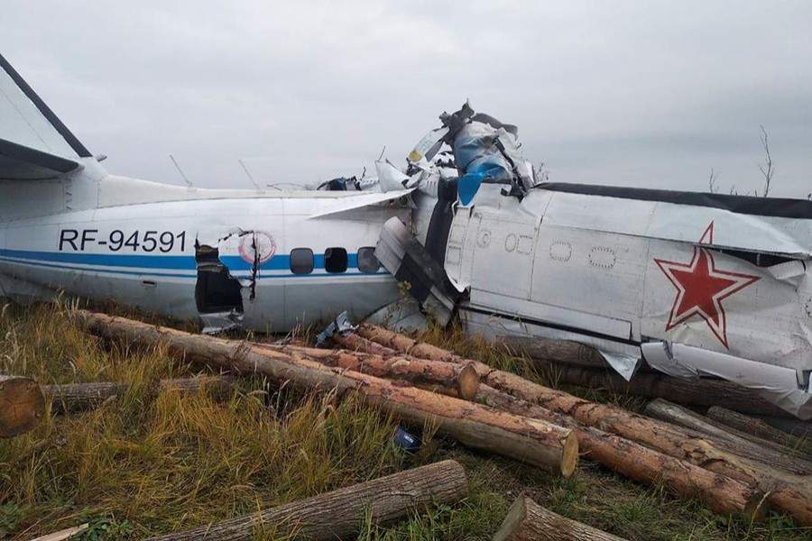 The wreckage of the L-410 plane is seen at the crash site near the town of Menzelinsk in the Republic of Tatarstan, Russia on October 10, 2021 — Russia's Emergencies Ministry/Handout via REUTERS