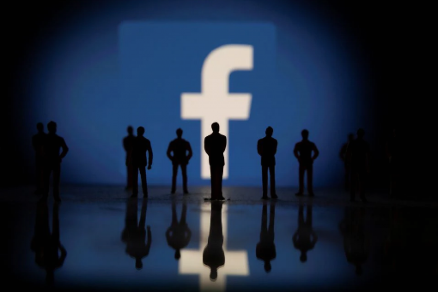 Small toy figures are seen in front of displayed Facebook logo in this illustration taken October 4, 2021. REUTERS/Dado Ruvic/Illustration