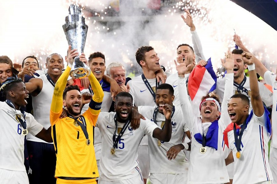 France's Hugo Lloris lifts the trophy as they celebrate after winning the Nations League