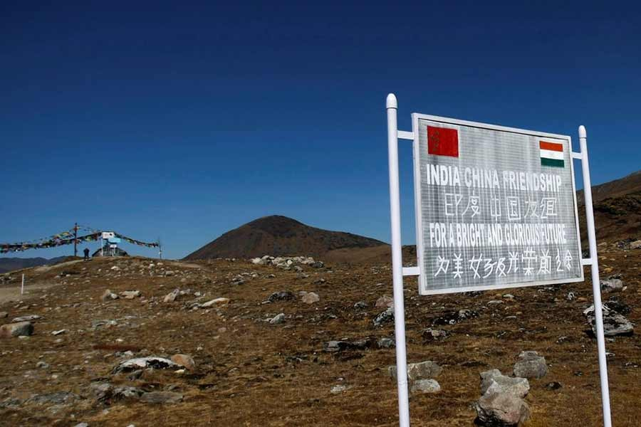 The Reuters file photo shows a signboard at the Indian side of the Indo-China border at Bumla, in the northeastern Indian state of Arunachal Pradesh.