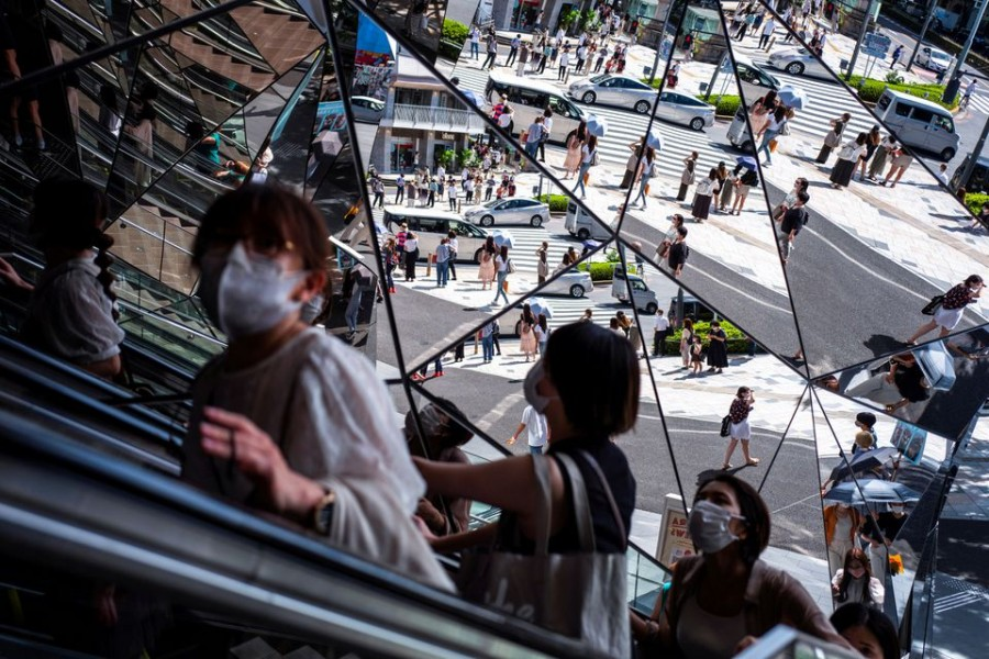 People wearing protective masks are reflected in the mirror at a shopping mall in Tokyo amid the coronavirus disease (Covid-19) outbreak in Tokyo, Japan on August 19, 2021 — Reuters/Files