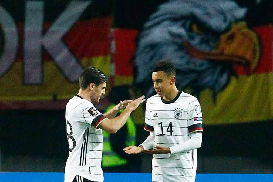 Germany's Jamal Musiala celebrates scoring their fourth goal with Jonas Hofmann during UEFA Qualifier against North Macedonia on Monday –Reuters photo