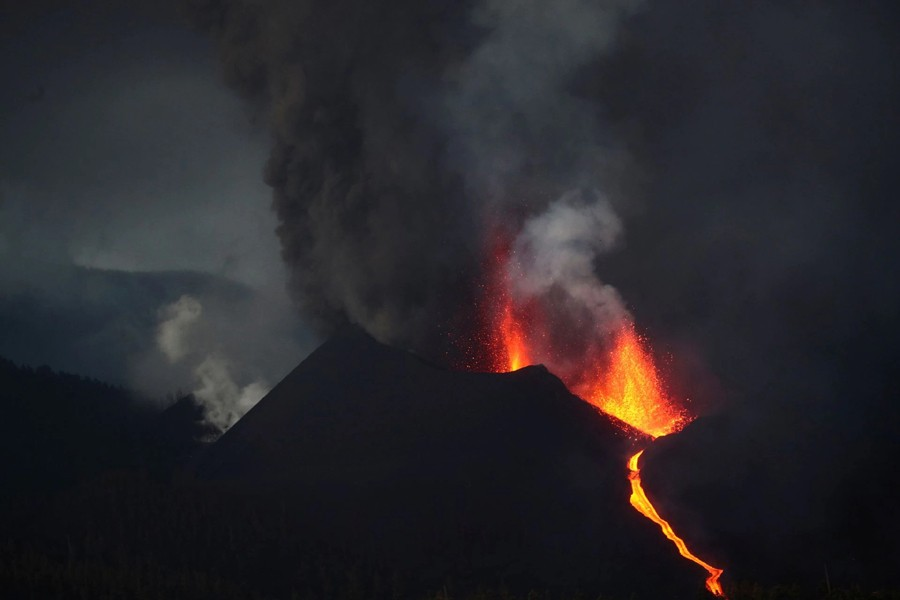 The Cumbre Vieja volcano spews lava and smoke as it continues to erupt on the Canary Island of La Palma, as seen from Tacande, Spain on October 12, 2021 — Reuters photo