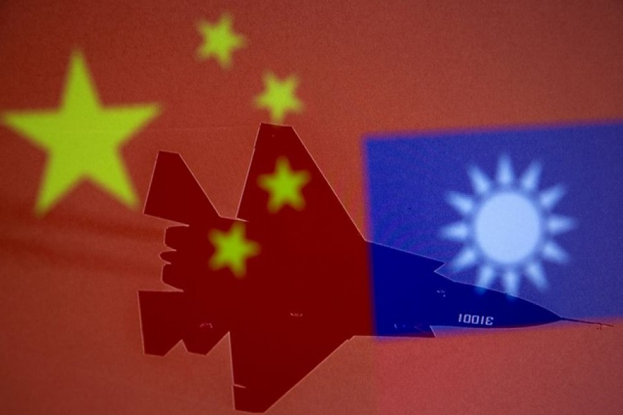 Taiwan says don't get too close as China defends military drills