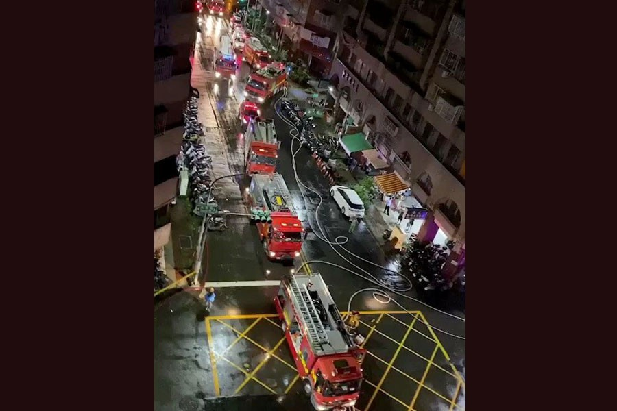 Fire trucks at the scene of a fire at Cheng Chung Cheng building in Kaohsiung, Taiwan in this still frame obtained from social media video dated early October 14, 2021. CHANG YU CHEN /via REUTERS